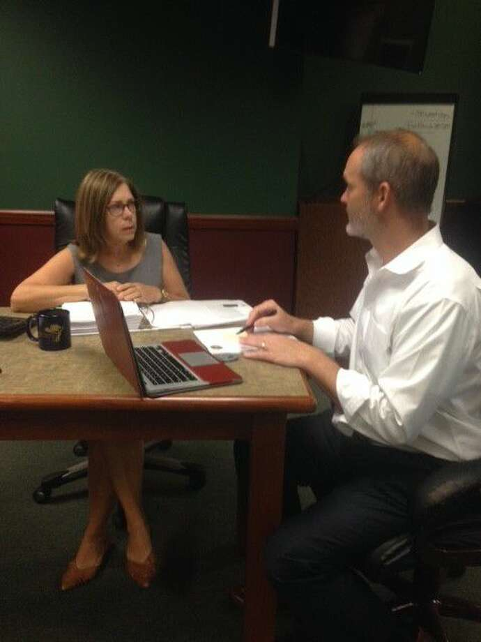 John Patterson, principal with Amence Development in Houston, talks with Magnolia Economic Development Coordinator Tana Ross about the city's new zoning requirements. The city enacted zoning statutes as part of the new unified development code developed by the city last year.