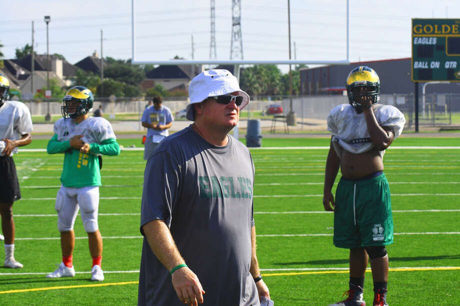 Cypress Falls defensive coordinator Chris Brister walks the field at practice Tuesday. Brister was alternatively described by players and head coach Kirk Eaton as a 'mastermind' and 'genius,' and - per Coach Eaton - deserves a lot of the credit for the way the Golden Eagles are playing on defense. Photo: Tony Gaines