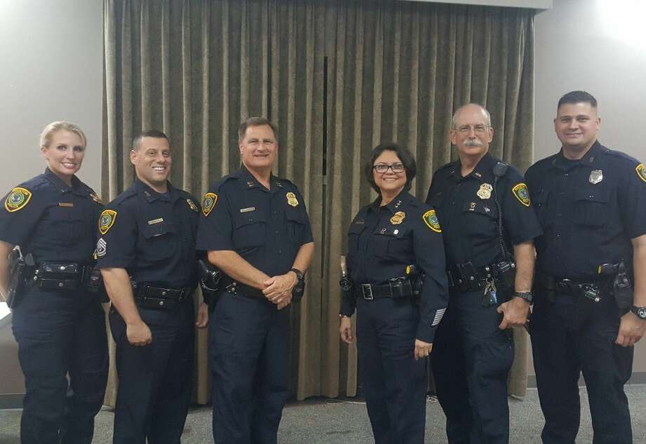 Houston Police Department personnel stop for a photo during a Kingwood Positive Interaction Program meeting at the Kingwood Church of Christ Sept. 20. Lieutenant Christina Salazar, left, Sergeant David Giannavola, Captain Mark Fougerousse, Chief Martha Montalvo, Lieutenant Don Atkins, Officer Daniel Von Quintus are pictured.