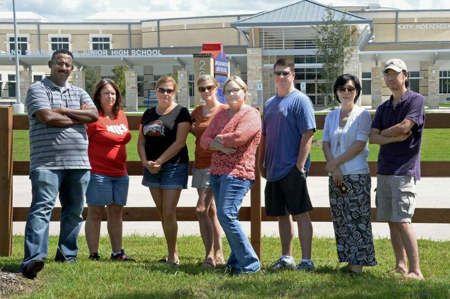 Parents of Tays Junior High School in Katy students show their frustration with District bus policies. Pictured from left are Aby Mattathu, Kim Jasman, Theresa Hennig, Kim Gold, Jen Webb, Ty Webb, Julie Yang and Brian Yang. Photo: Staff