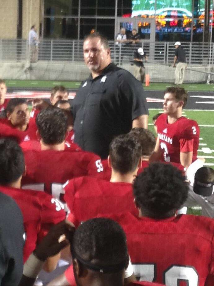 Porter head coach Jim Holley speaks to his team last Thursday after a 37-34 overtime win over Crosby at Texan Drive Stadium.