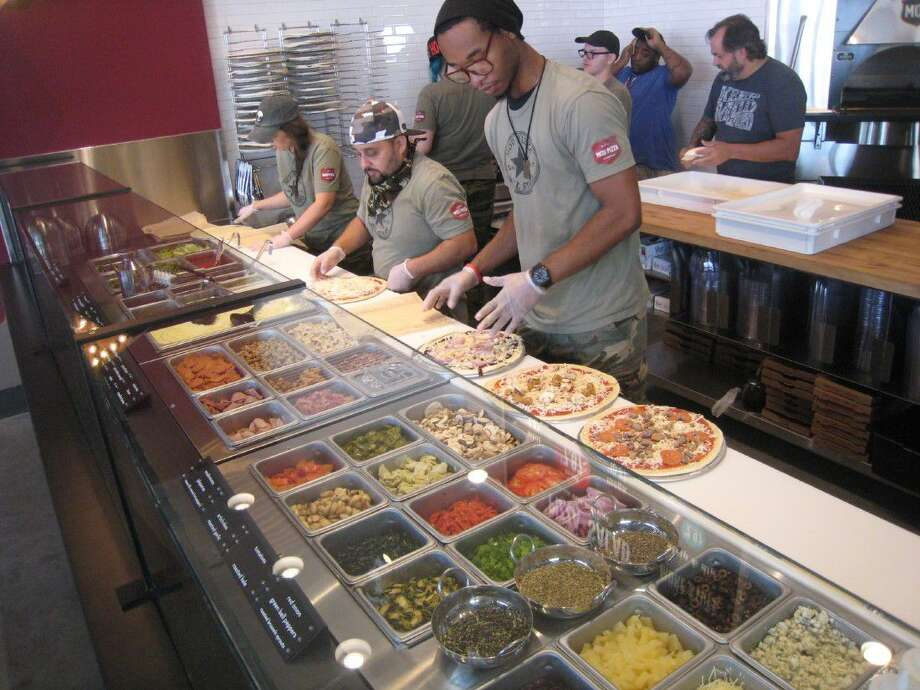 "At MOD, which stands for ""made-on-demand,"" the customer can add as many toppings as they wish from 30 different toppings for their own individualized 11-inch thin-crust pizza, which is ready in three minutes, for $7.47 which is made and cooked in front of the customer."