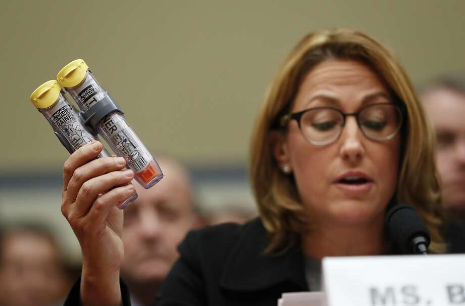 FILE - In this Wednesday, Sept. 21, 2016, file photo, Mylan CEO Heather Bresch holds up EpiPens while testifying on Capitol Hill in Washington, before the House Oversight Committee hearing on EpiPen price increases. On Friday, Oct. 7, 2016, Mylan agreed to pay $465 million to settle Justice Department allegations that it overbilled Medicaid for its life-saving EpiPen allergy injection. (AP Photo/Pablo Martinez Monsivais, File) Photo: Pablo Martinez Monsivais, Associated Press