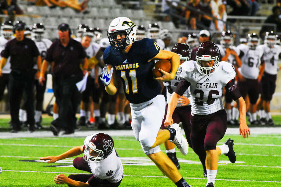 Cypress Ranch senior quarterback Blake Nevins rushes for a touchdown against Cy-Fair at Cy-Fair FCU Stadium Thursday, Sept. 22, 2016. Although Nevins struggled passing, completing only 10 of his 24 attempts, he was able to move the ball with his feet, racking up 133 yards and two touchdowns on 11 carries. Photo: Tony Gaines