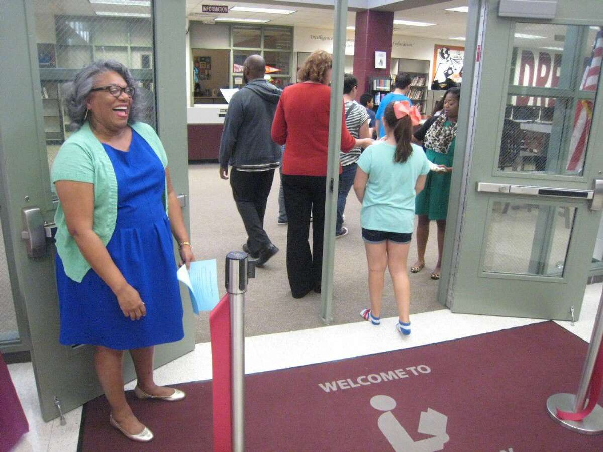 Timberwood Middle School librarian Sue White welcomes guests into the newly renovated library during the ribbon cutting ceremony Sept. 22.