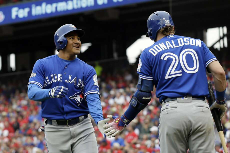 Toronto's Ezequiel Carrera receives congratulations from Josh Donaldson for his solo home run off Texas' Yu Darvish. Photo: LM Otero, Associated Press