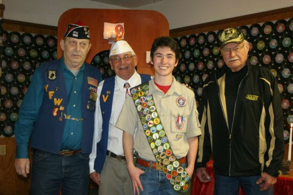 VFW Post members James Ault, Ricky Clardy and Paul Rich congratulate Corey Rodriguez on his accomplishments as an Eagle Scout.