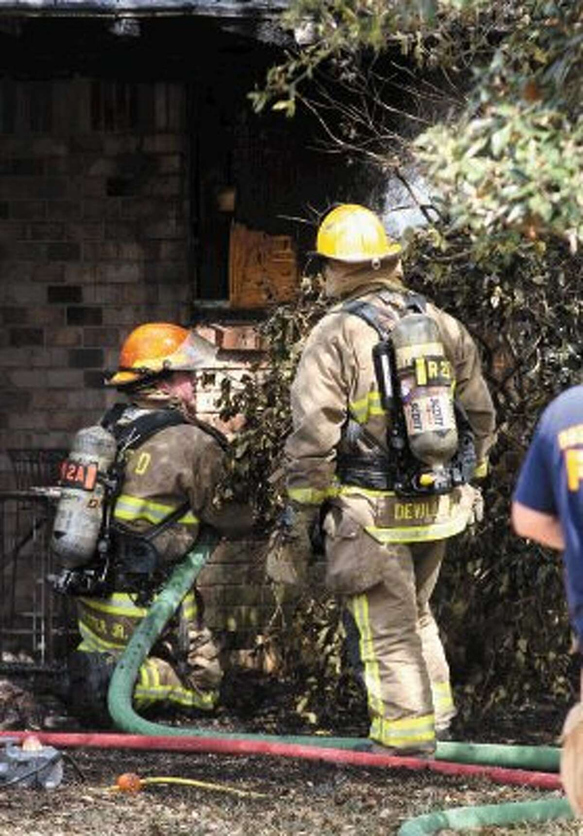 League City Firefighters work at a house fire on Moody Avenue.