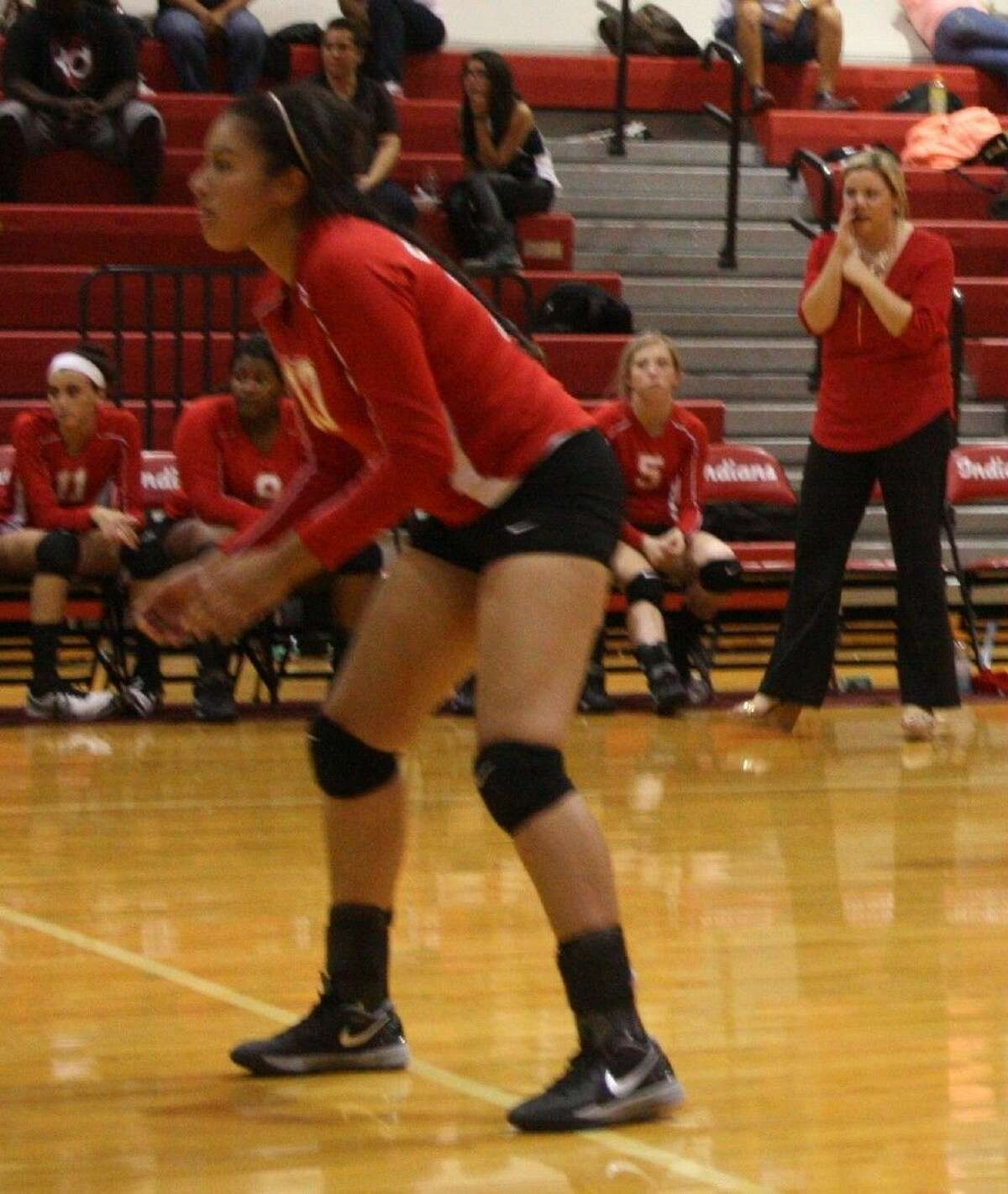 Olivia Rivera anticipates the ball from the Lady Trojans while Coach Kara Rodgers watches from afar.