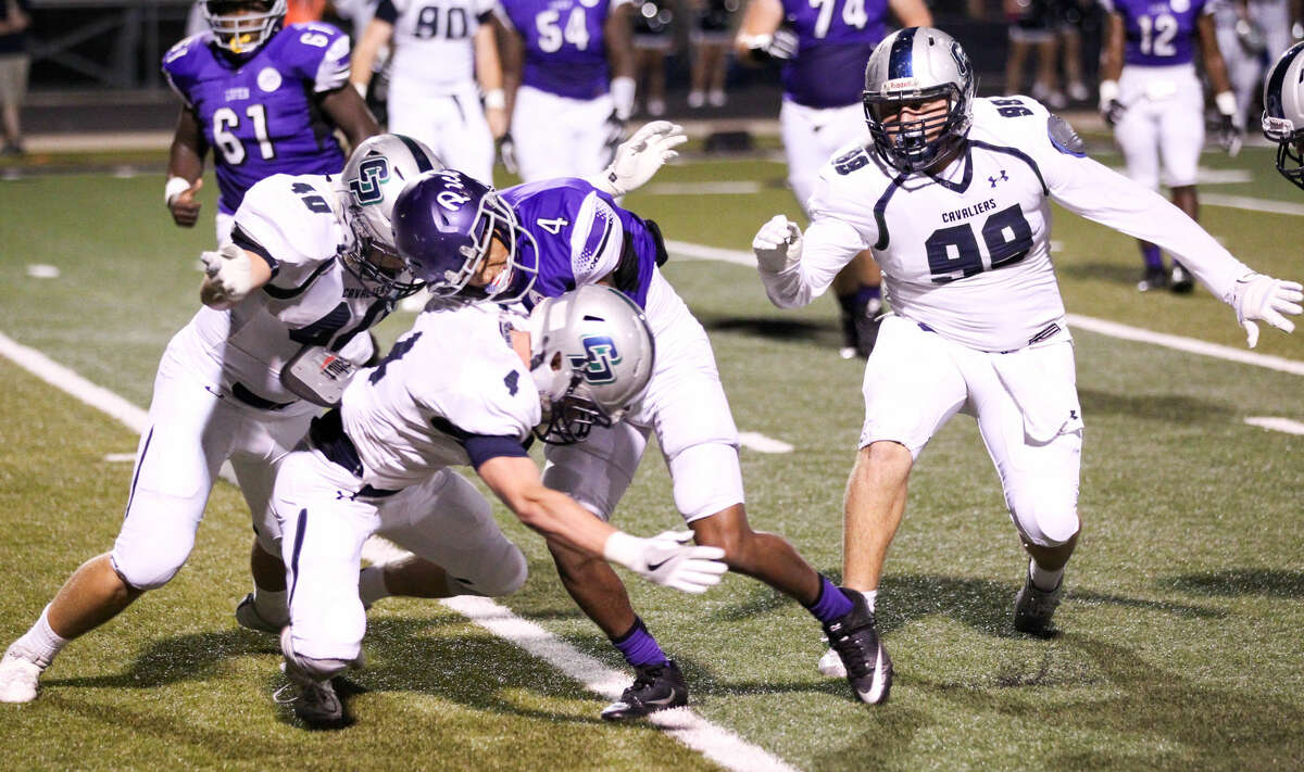 College Park defenders Joshua Mrazek (40), Eric Bordovsky (4) and Anthony Tanguma (99) converge on Lufkin receiver Javante Ellington (4) in the first half of the Cavaliers' game against Lufkin on Friday night at Abe Martin Stadium in Lufkin.