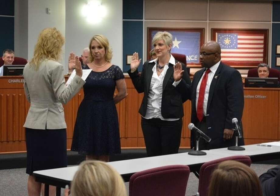 New Katy ISD trustees Ashley Vann, Courtney Doyle, and Henry Dibrell are sworn in. Photo: Photo Courtesy Of Katy ISD