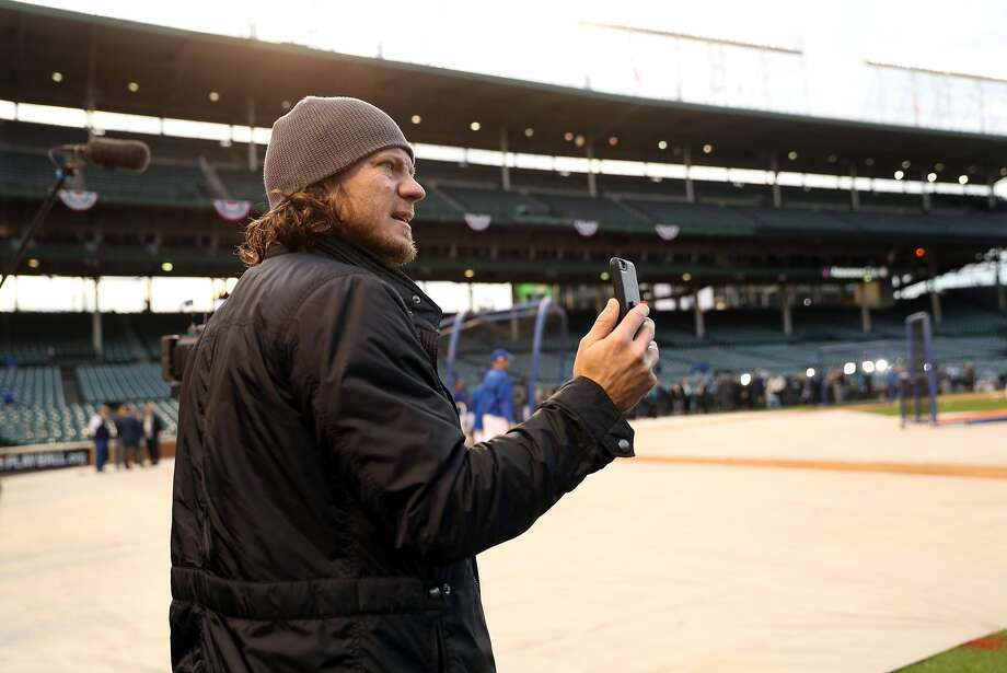 San Francisco Giants' Jake Peavy takes a video before Giants play Chicago Cubs in Game 1 of the National League Division Series at Wrigley Field in Chicago. IL, on Friday, October 7, 2016. Photo: Scott Strazzante, The Chronicle