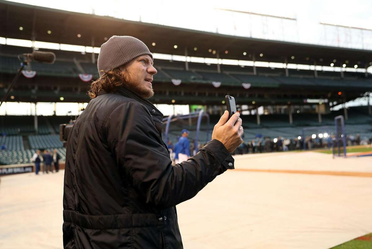 San Francisco Giants' Jake Peavy takes a video before Giants play Chicago Cubs in Game 1 of the National League Division Series at Wrigley Field in Chicago. IL, on Friday, October 7, 2016.