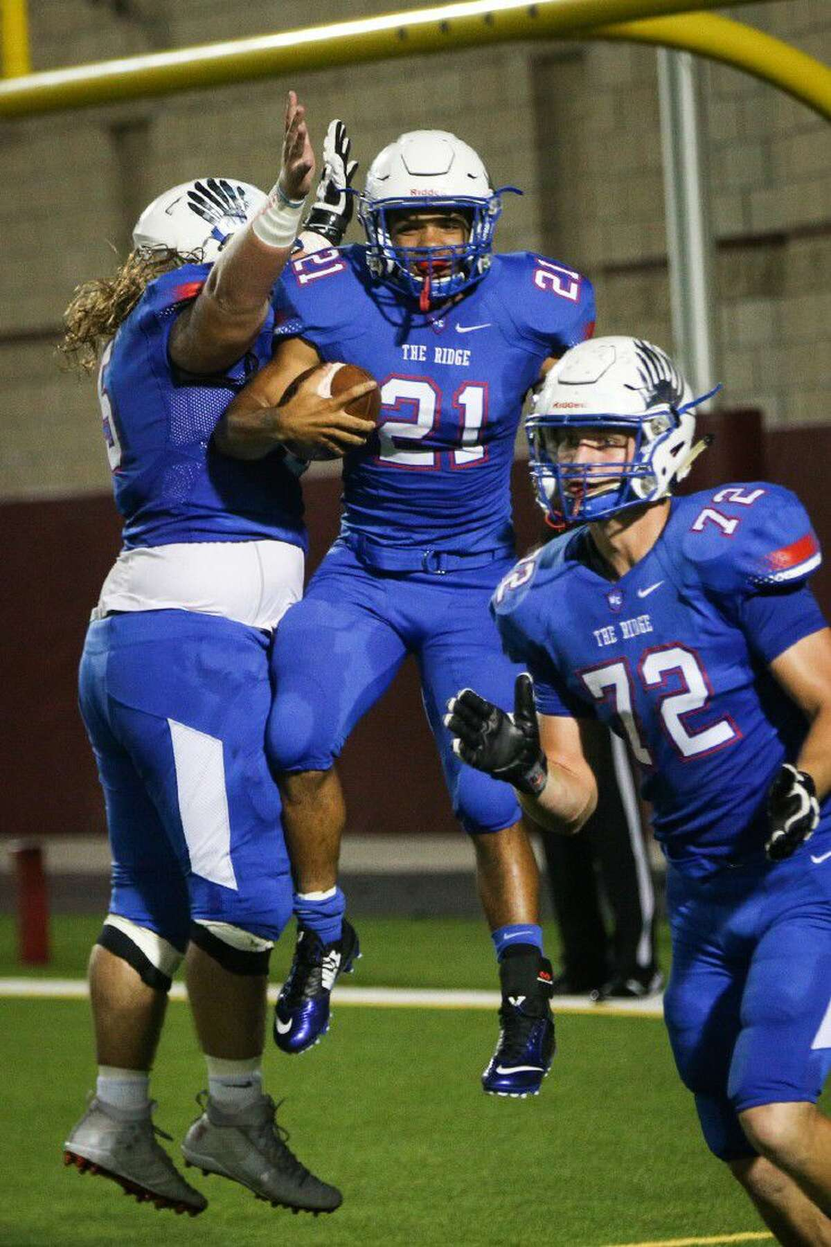 Oak Ridge's Jimmie Moore (21) celebrates with teammates after scoring a touchdown during the varsity football game against Conroe on Friday, Sept. 16, 2016, at Woodforest Stadium in The Woodlands, Texas. To view more photos from the game, go to HCNPics.com.