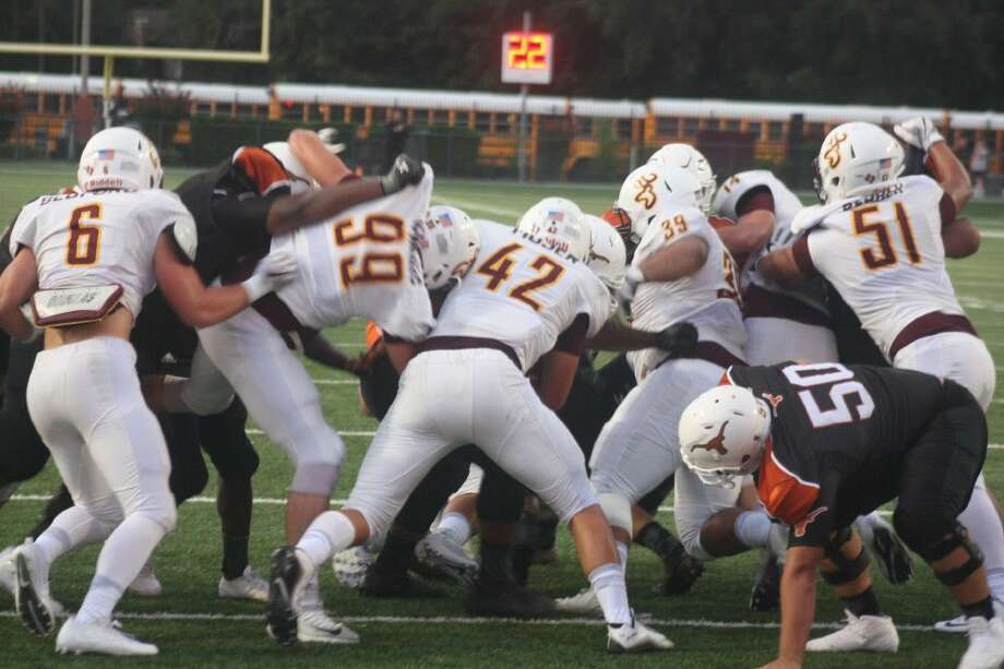 Race Moser (42), Brody Jenkins (99) and the rest of the Deer Park defense stops a Dobie ballcarrier at the goal line in the first quarter. Photo: Robert Avery