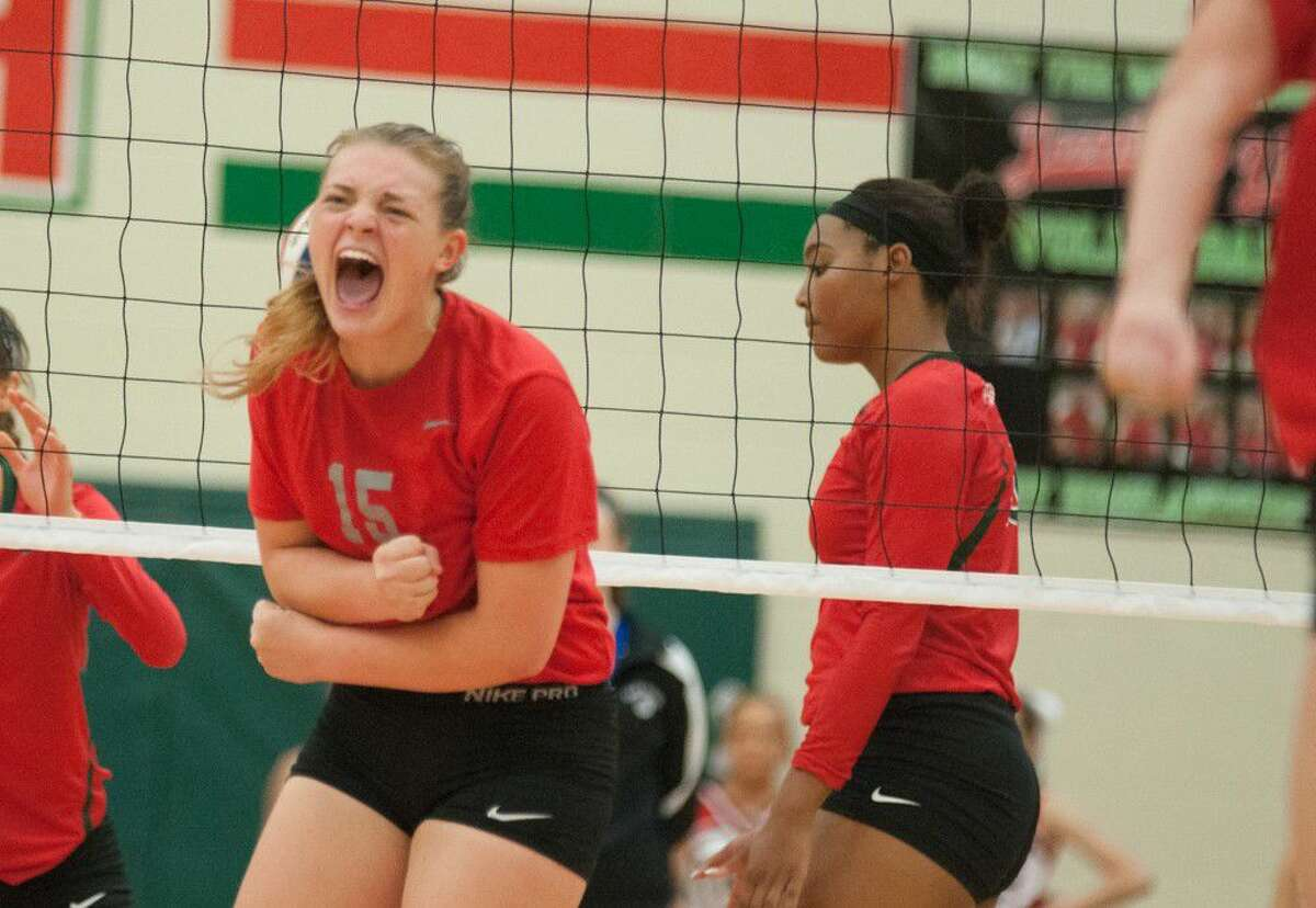 Oak Ridge's Hailey Lohnes celebrates the final point after beating The Woodlands on Friday at Oak Ridge High School.