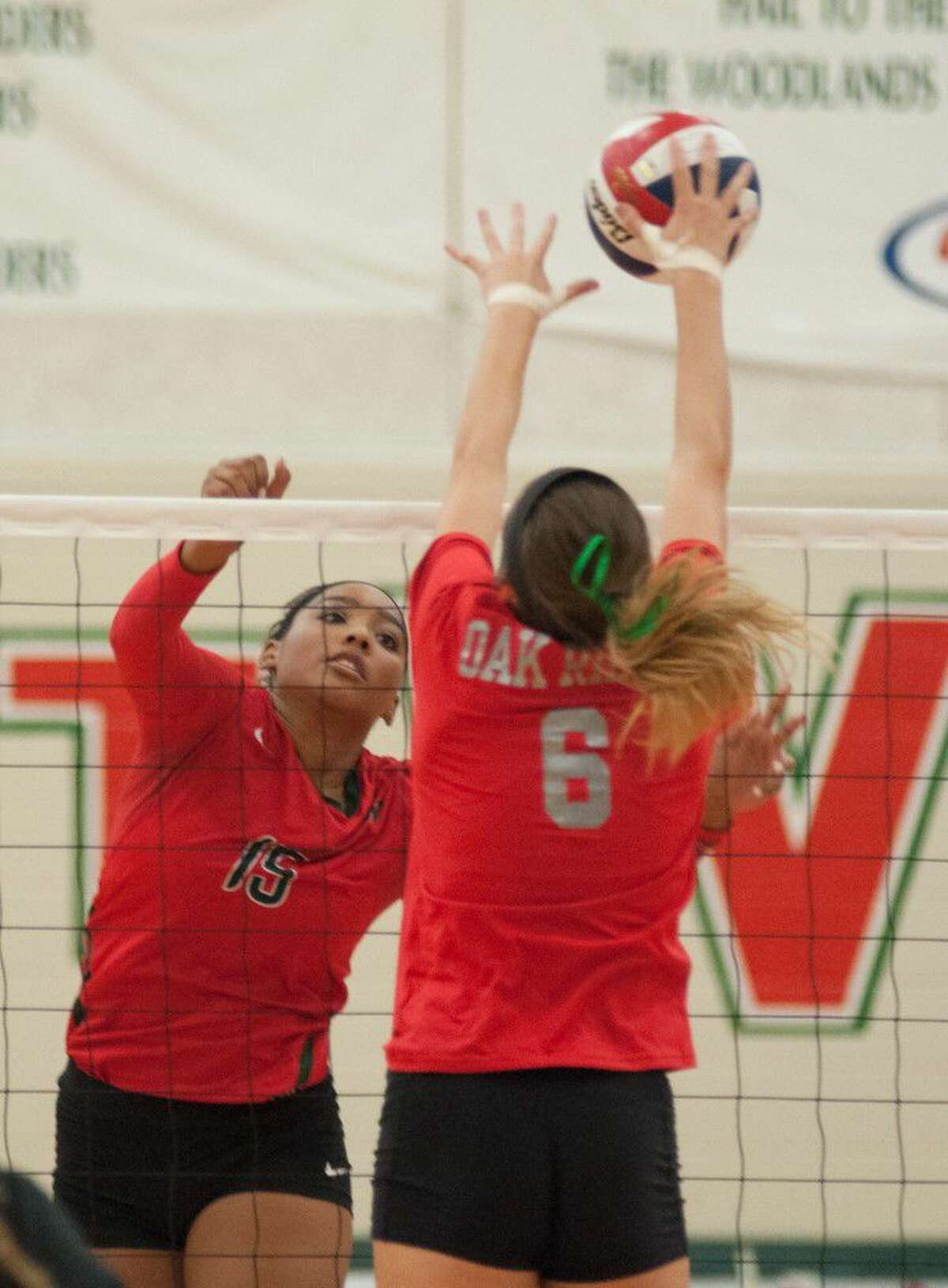 Oak Ridge's Molly Russell gets a block against The Woodlands' Sydney Jackson on Friday at The Woodlands High School.