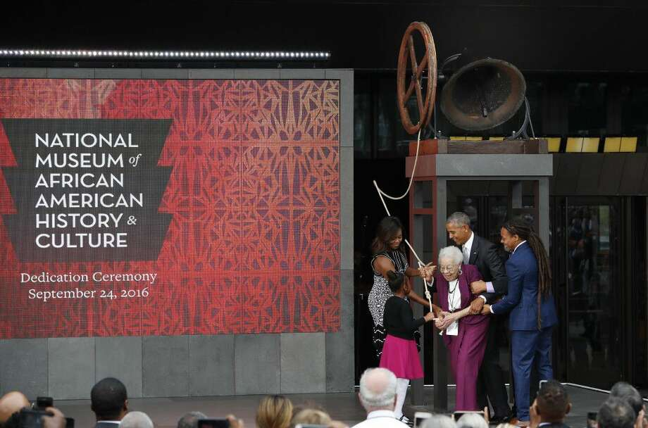 President Barack Obama and first lady Michelle Obama, ring the Freedom Bell: First Baptist Church of Williamsburg, with members of the Bonner family at the dedication ceremony for the Smithsonian Museum of African American History and Culture on the National Mall in Washington, Saturday.