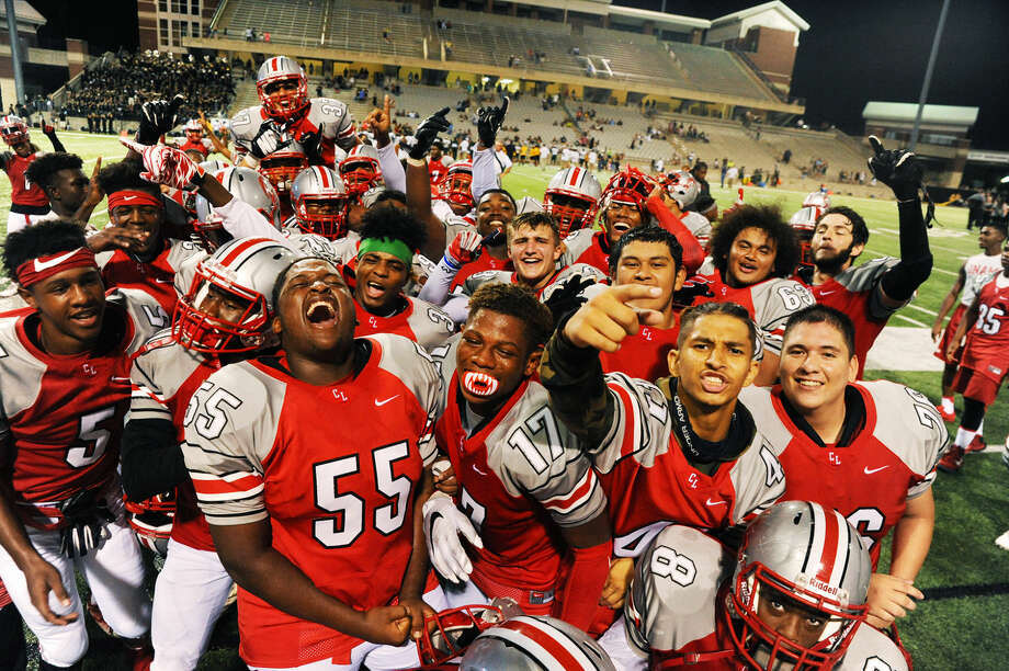 The Cypress Lakes Spartans celebrate after the 31-14 victory against Cypress Falls Saturday, Sept. 24, 2016 at Cy-Fair FCU Stadium. The Spartans set a school record for wins in a season, but - with six games remaining - head coach Ronald Patton says the team is still hungry for more. Photo: Tony Gaines