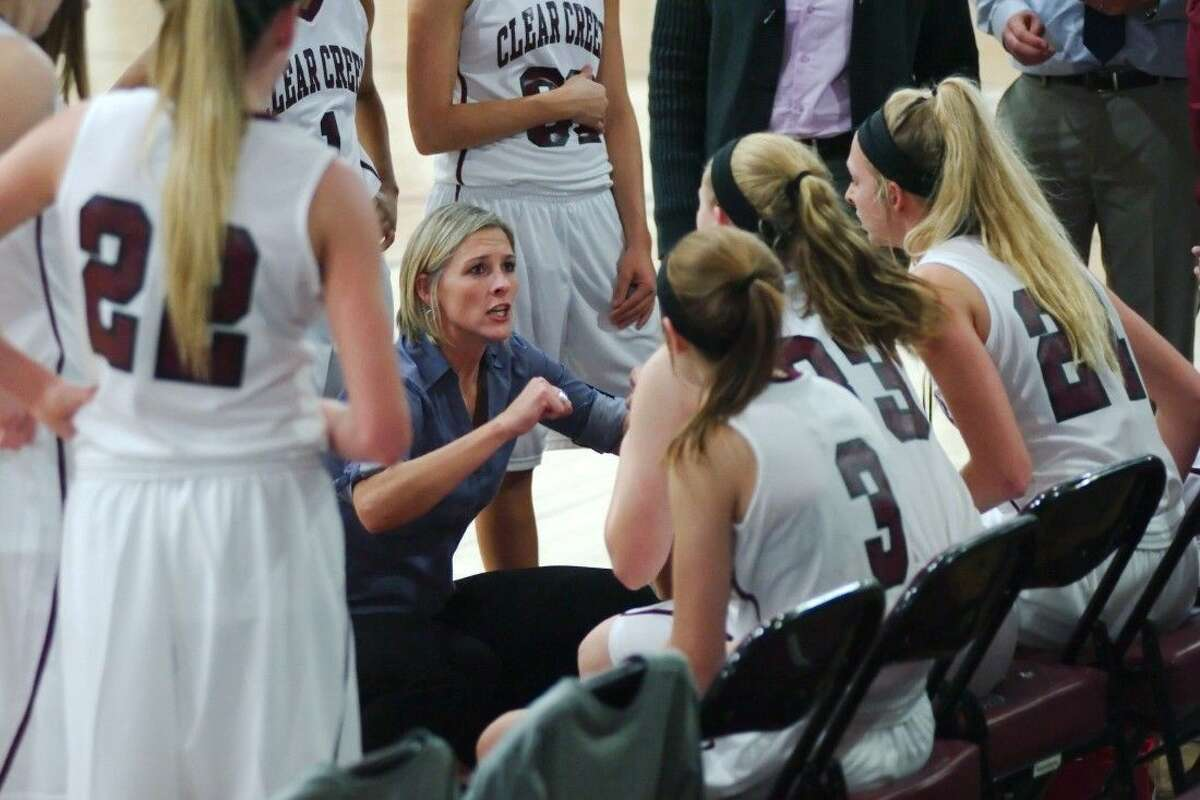 Clear Creek first-year head coach Kristi Odom talks to her team during a timeout Tuesday night against Summer Creek.