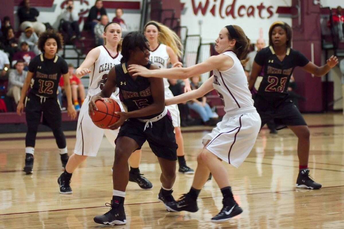 Summer Creek's Anneisha Williams (5) is guarded by Clear Creek's Dezarae Graves (3) Tuesday night.