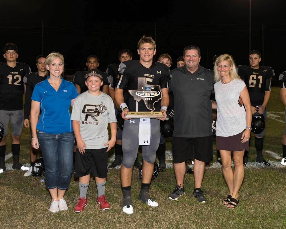 Northland Christian Quarterback Michael Massarella is honored with the Built Ford Tough Player of the Week Award at halftime of Friday's game against Bay Area Christian. Massarella, says head coach David Nelson, is a leader both on the field and off, and a major contributor to the success the Cougars are enjoying in the early season.