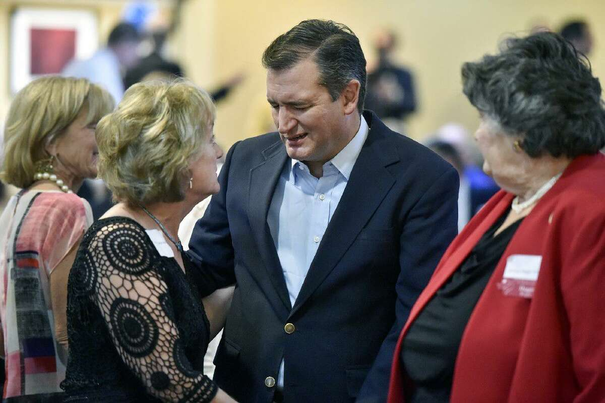 Sen. Ted Cruz, R-Texas, center, talks with Cathie Adams, past president of Texas Eagle Forum, at the annual Grassroots America We The People Champions of Freedom award dinner Friday in Tyler.