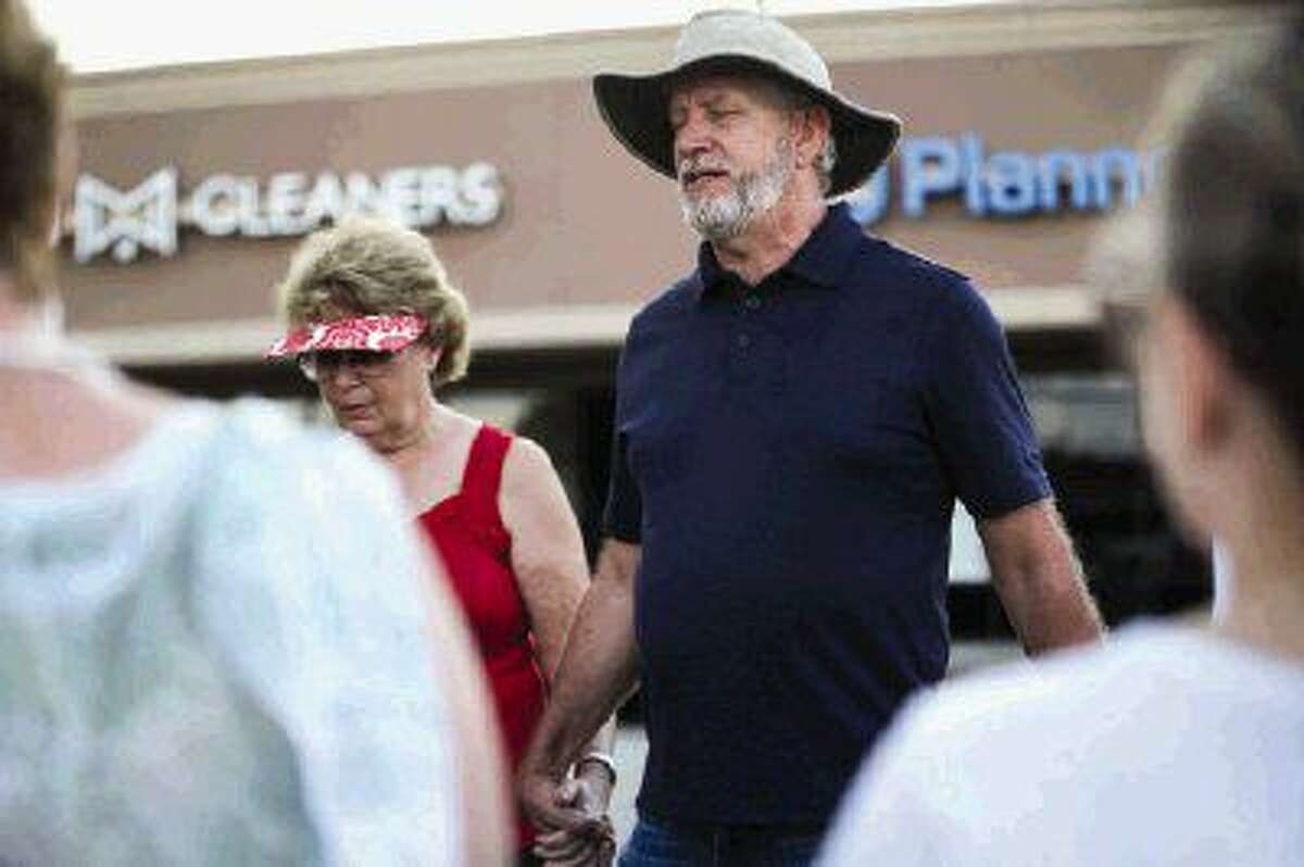 Executive Pastor Randy Ball, of The Woodlands Bible Church, leads a group in prayer outside of Planned Parenthood in Spring in 2016.
