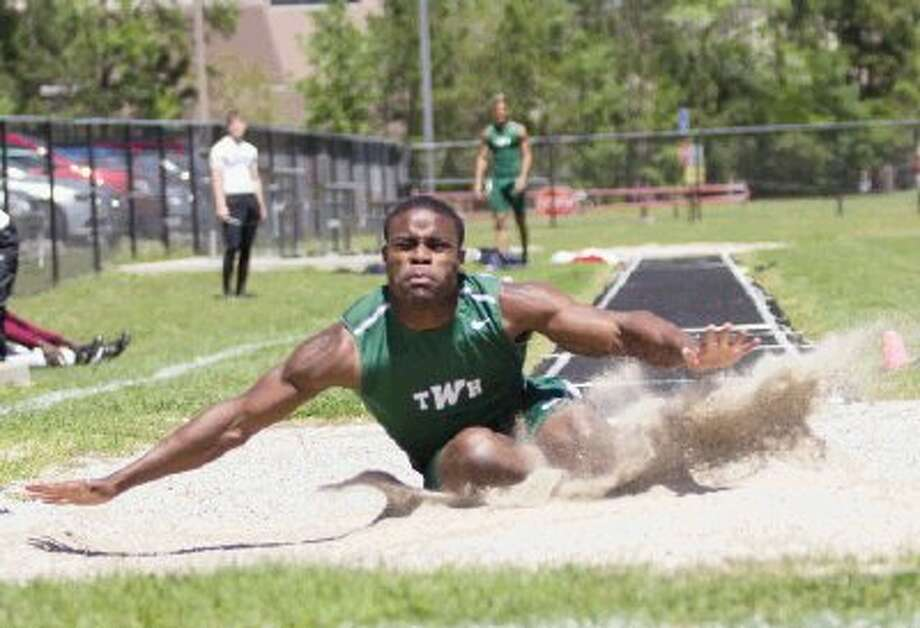 The Woodlands' Patrick Carr, here competing in the District 14-5A meet, finished second in the area championships in the long jump. / The Conroe Courier/ The Woodland
