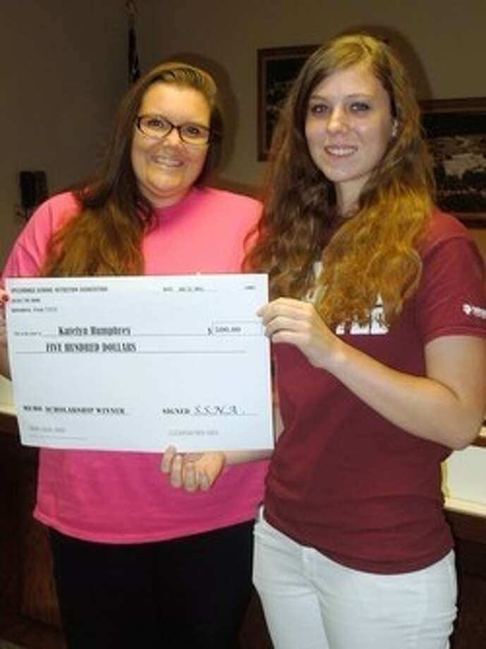 Splendora School Nutrition Association President Amber Pitts helped recognize scholarship recipients at the July meeting of the SISD school board. Among them were Kimberly Villalobos and Katelyn Humphrey (pictured). Photo: Submitted Photo