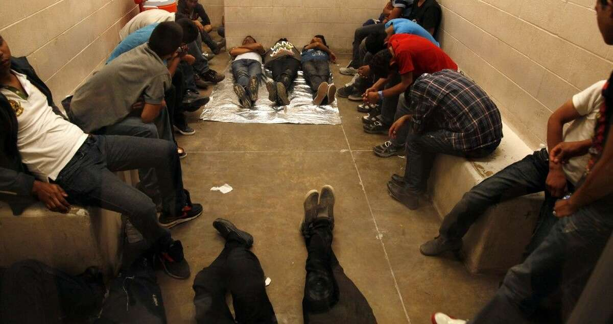 Immigrants who have been detained while crossing the border are held inside the McAllen Border Patrol Station in McAllen July 15. More than 350 detainees were being held at the station. A solution for the growing crisis of tens of thousands of unaccompanied children showing up at the U.S.-Mexico border is looking increasingly elusive with three weeks left before Congress leaves Washington for an annual August recess.
