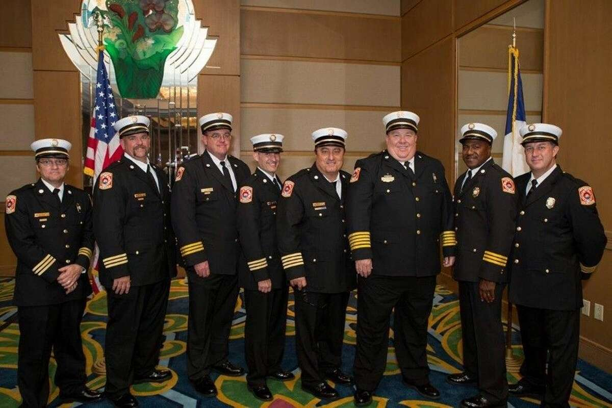 Five new battalion chiefs of the Galveston Fire Department are ready for the call of duty - and four are College of the Mainland graduates. From left, Battalion Chief Gary Staudt, Battalion Chief Tim Johnson, Battalion Chief Thomas Winn, Battalion Chief Chris Harrison, Assistant Chief Charles Olsen, Fire Chief Mike Wisko and Battalion Chief Andy Bowen.