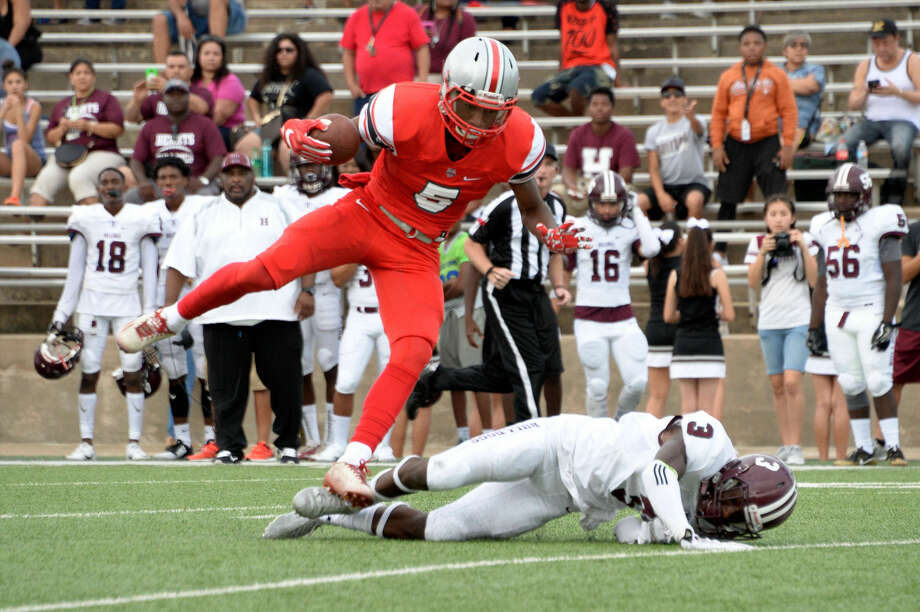 Arjei Henderson caught four touchdown passes as Travis rolled to a record-setting 86-20 victory against Clements in the District 20-6A opener for both teams. The Tigers play Dulles next week. Photo: Craig Moseley