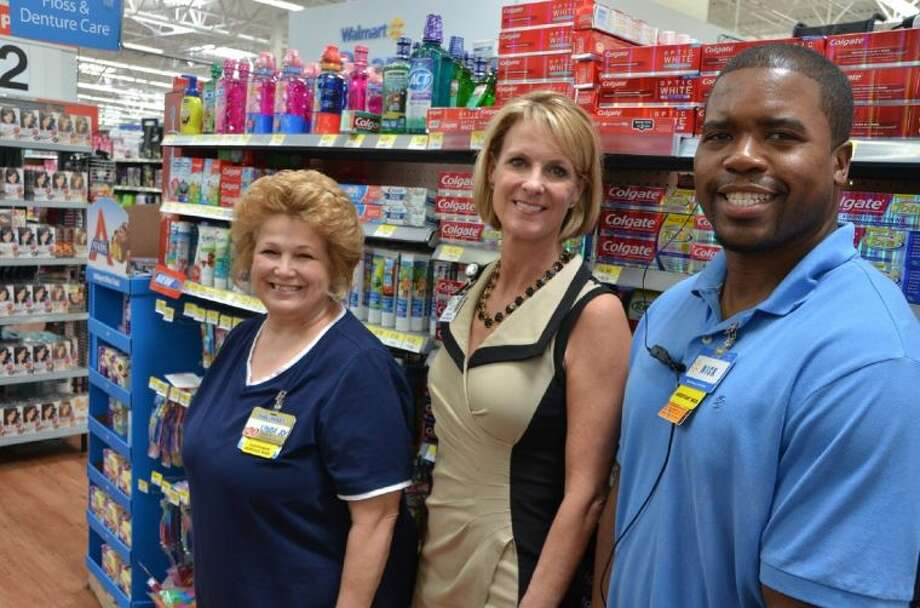 Leslie Francis, center, director of marketing and business relations, thanks Copperfield Walmart store manager Linda Joy Kleinfelder and assistant manager Nick Harvey during a recent visit to the 15955 F.M. 529 location. Shoppers at this location, as well as three other Walmart stores in CFISD, donated Colgate items back to district students through the Champions for Kids SIMPLE Giving program. Photo: Submitted Photo