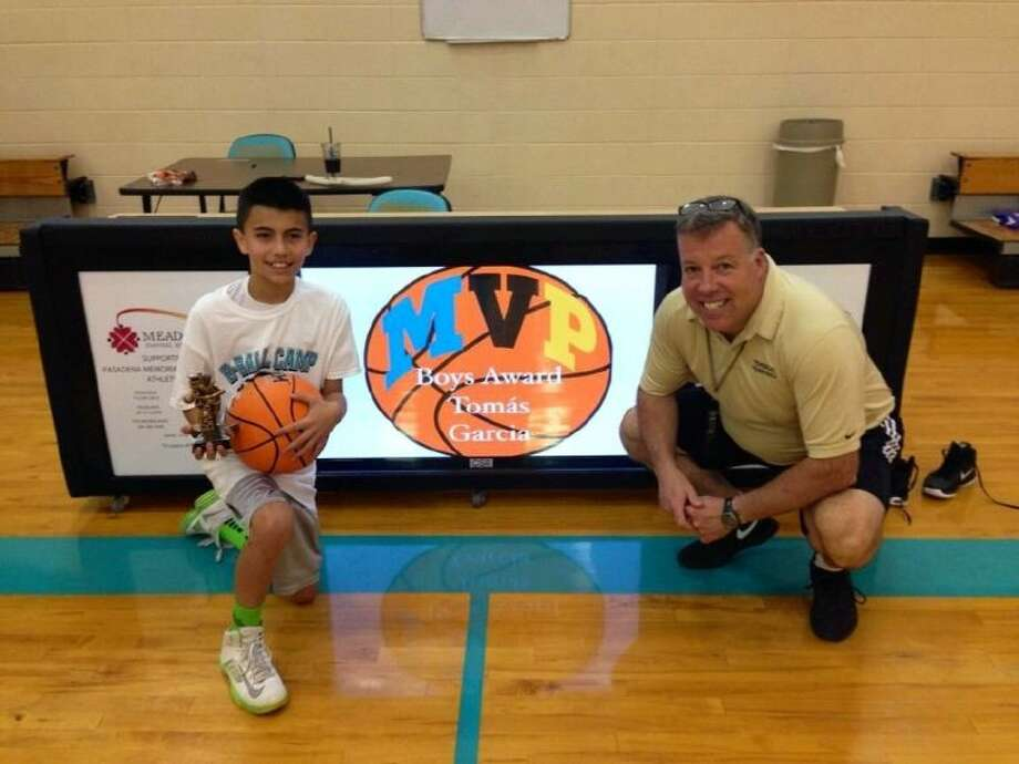Tomas Garcia was presented the Boys MVP trophy by coach Chris Gross at this past week's four-day camp. Photo: Courtesy Photo
