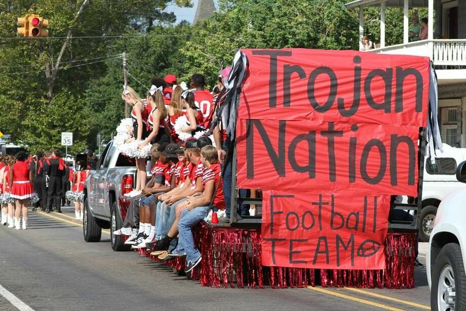 Trojan football players and cheerleaders waved to the crowd during the San Jacinto County Fair & Rodeo Parade on Saturday, Sept. 17. Photo: Submitted