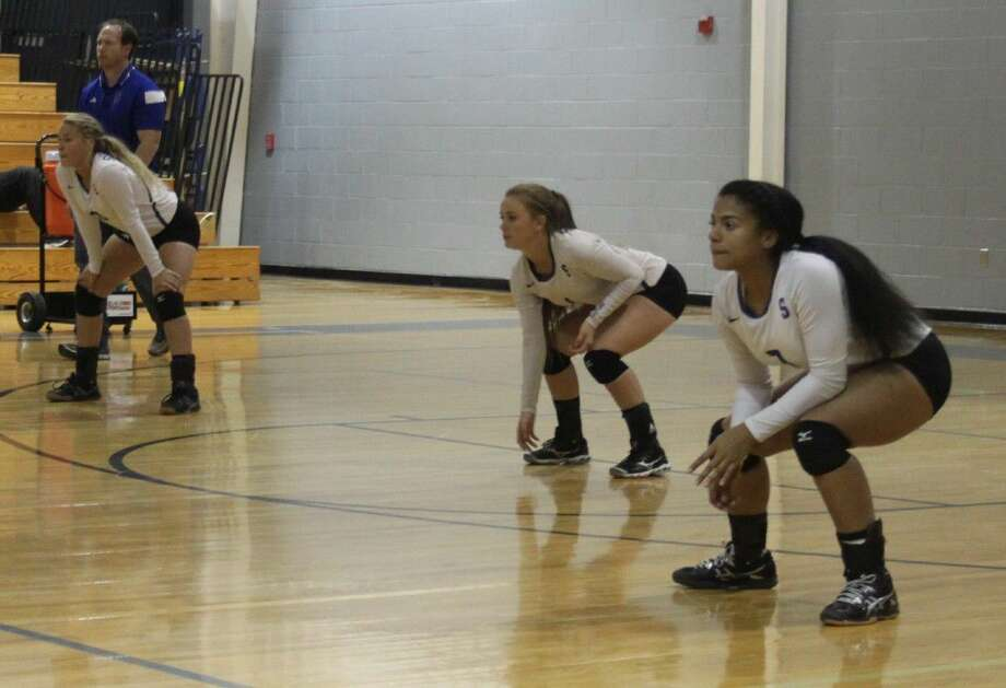 Dally Hightower (left), Keeley Wright (middle) and Erieanna Lopez (right) of the Lady Pirates prepare to defend against the Lady Panthers. Photo: Jacob McAdams