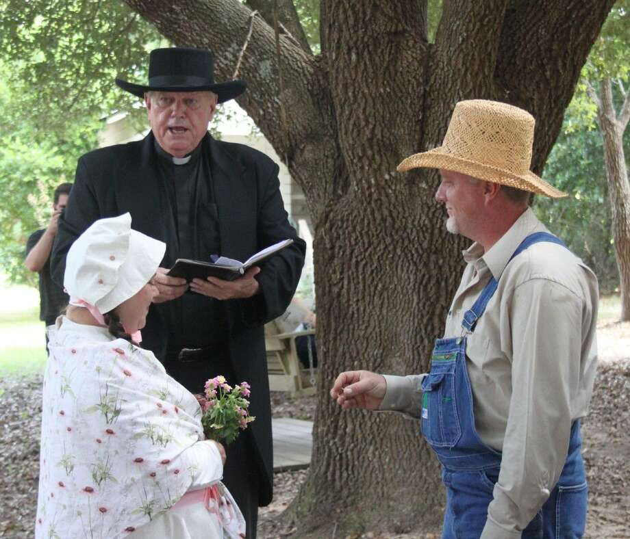 Reverend B. Moore Pious (center), portrayed by Dale Everitt joins Robert Elledge (right) and Brandy Drigger (left) in holy, albeit reluctant matrimony during the shotgun wedding held at Heritage Days on Sept. 23. Photo: Jacob McAdams