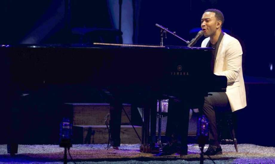 John Legend performs in concert at the Cynthia Woods Mitchell Pavilion in The Woodlands July 23. Visit www.woodlandscenter.org for more upcoming concerts at the Pavilion. Photo: Jason Fochtman