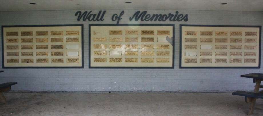 The Wall of Memories is on one side of the Shepherd Public Library. The library is currently in the process of replacing the plaques and moving them inside the library while the wall will be possibly be turned into a mural. Photo: Staff Photo By Jacob McAdams