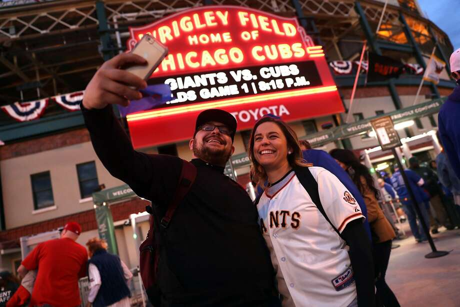 San Francisco Giants' fans Jamie Ramirez and Cheryl Tatge of Sacramento pose in front of Wrigley Field marquee before Giants play Chicago Cubs in Game 1 of the National League Division Series in Chicago. IL, on Friday, October 7, 2016. Photo: Scott Strazzante, The Chronicle