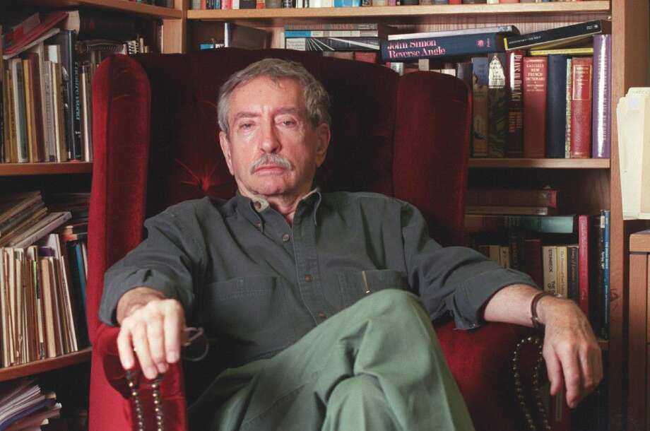 Playwright Edward Albee talks in 2001 about his annual spring semester teaching playwriting at the University of Houston. Pearland Junior High East teacher John Grimmitt was one of his students Photo: John Everett