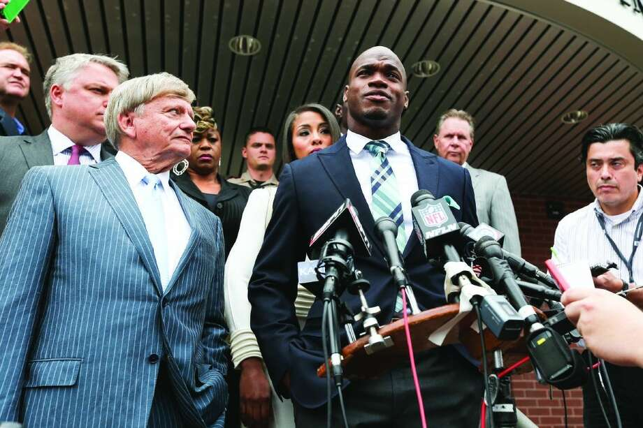 Minnesota Vikings running back Adrian Peterson speaks during the press conference after his hearing on Nov. 4 at the Lee G. Alworth Building in Conroe. Peterson avoided jail time in a plea agreement reached with prosecutors that includes two years probation, 80 hours community service and deferred adjudication. He was charged with reckless assault for causing injury to his 4-year-old son.
