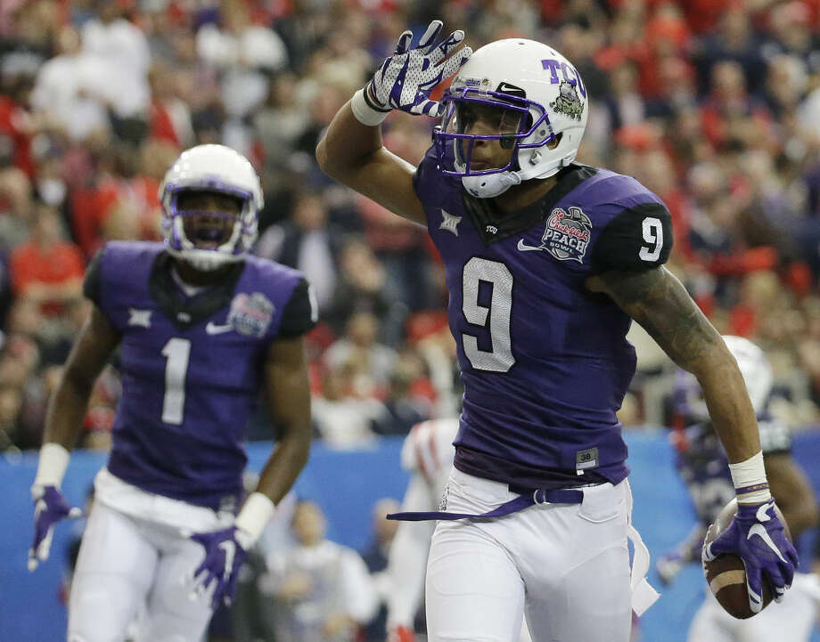TCU wide receiver Josh Doctson (9) celebrates his touchdown against Mississippi during the first half of the Peach Bowl NCAA football game, Wednesday, Dec. 31, 2014, in Atlanta. (AP Photo/David Goldman) Photo: David Goldman