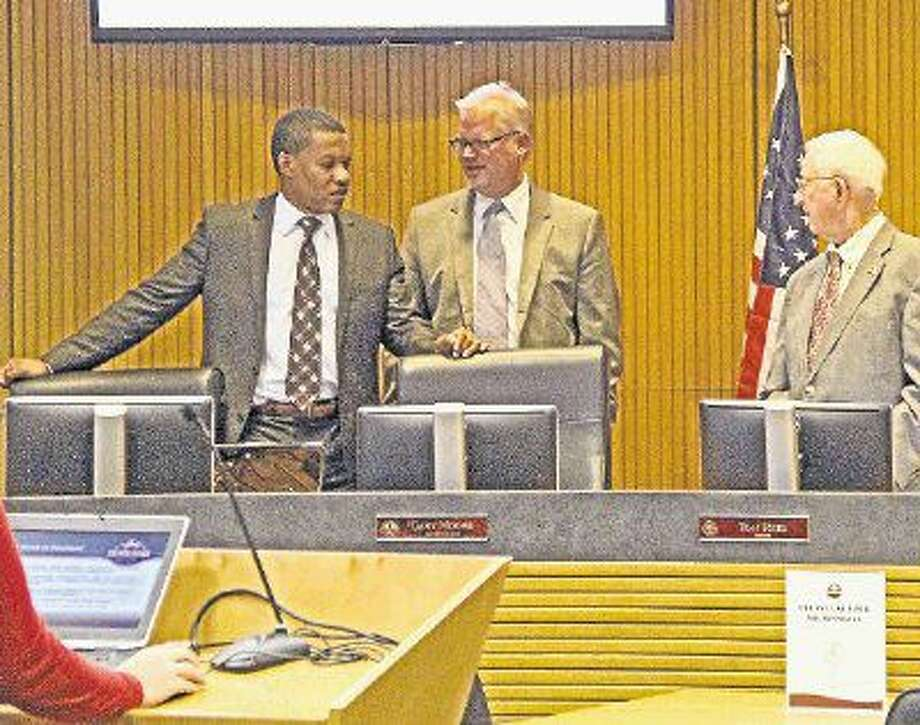 Pearland City Councilman Derrick Reed, left, City Manager Clay Pearson and Mayor Tom Reid talk on Sept. 12 when the council discussed lowering the property tax rate, which it did Sept. 19. Photo: Kristi Nix