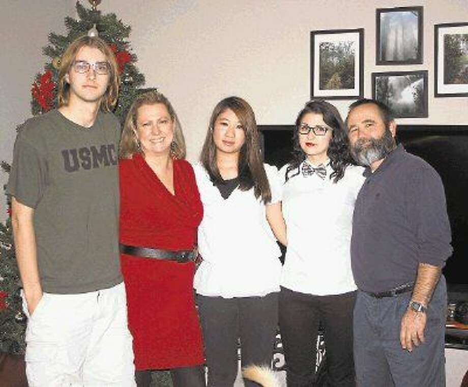 Ami Kano (center) is a foreign exchange student from Japan. She attends Tarkington ISD and is hosted by the Gregory family. From left to right: Joe Gregory, Cassie Gregory, Kano, Savannah Gregory and Dalton Gregory. Photo: Jacob McAdams