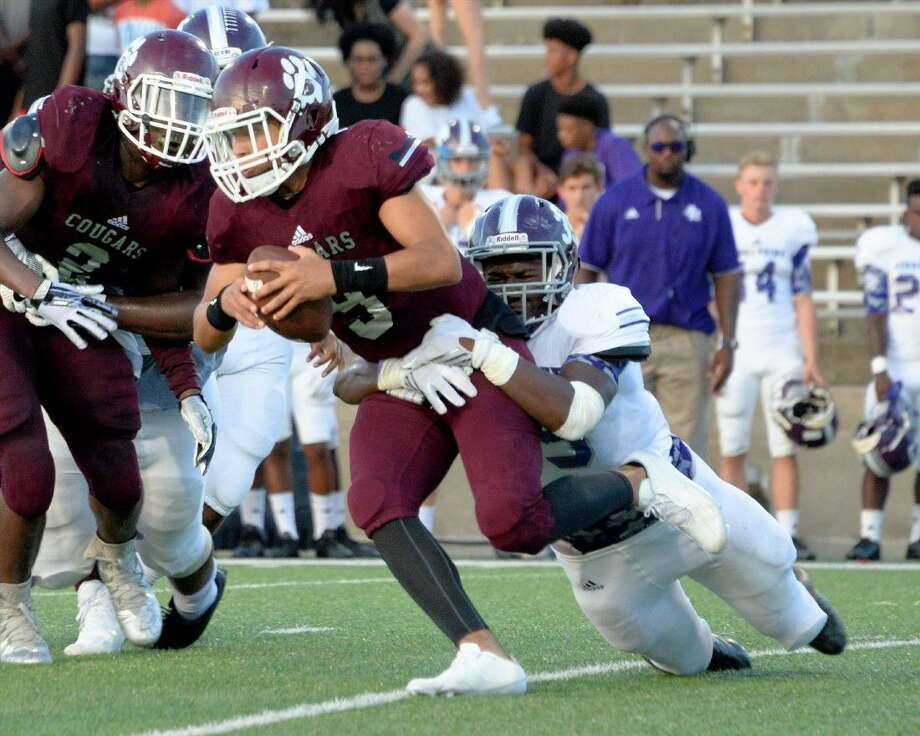 Kempner quarterback Alec Carr (9) is brought down by Ridge Point's Nick Livingston (35) during the Panthers' dominant 49-8 win last week. Photo: Craig Moseley
