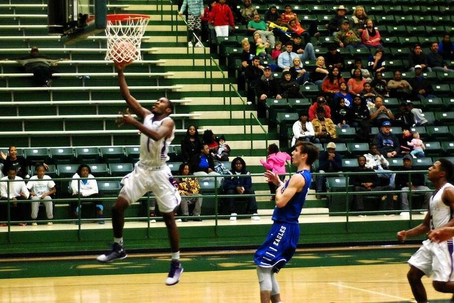 Jacarius Keener shoots on a breakaway for Dayton in the championship game against New Caney at the Livingston Holiday Hoopfest, Dec. 31, 2014. Photo: Casey Stinnett