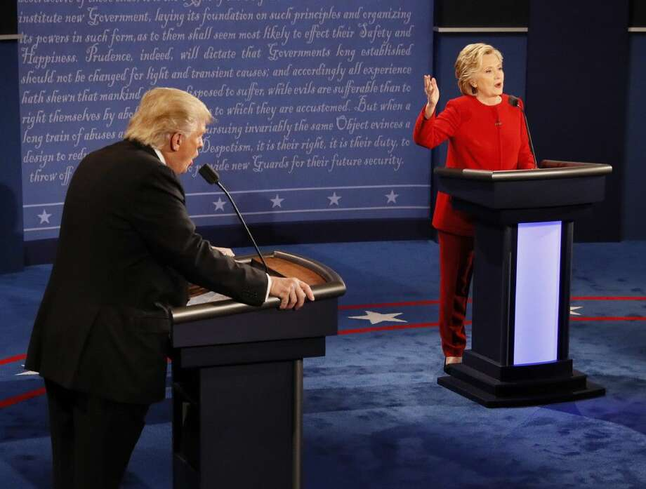 Republican presidential nominee Donald Trump and Democratic presidential nominee Hillary Clinton speak at the same time during the presidential debate at Hofstra University in Hempstead, N.Y., Monday.