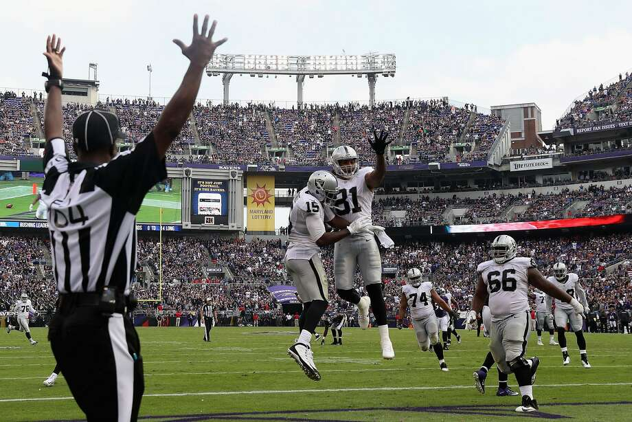 The Raiders' Michael Crabtree (15) celebrates his tying touchdown catch with Mychal Rivera, with 2:12 on the game clock in Baltimore last Sunday. The extra point made it a 28-27 win. Photo: Rob Carr, Getty Images